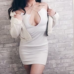 Dresses & Skirts - White cut out strapped dress.